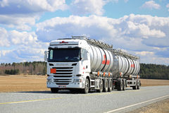White Scania Liquid Tanker Trucking on Beautiful Day stock image
