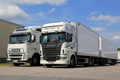 White Scania R560 and Volvo FH Full Trailer Trucks Royalty Free Stock Photo