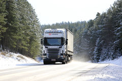 White Scania Semi on Winter Forest Highway Royalty Free Stock Photos