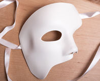 White Scary Halloween mask on wood Stock Photography