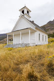 White schoolhouse, Oregon, USA. Abandoned white wood schoolhouse in field of wildflowers in Oregon, USA Stock Photography