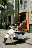 White scooter. Parked in front of Victorian houses in San Francisco Royalty Free Stock Images