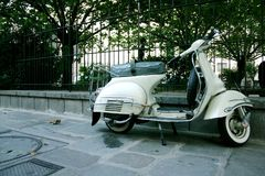 White scooter. Parked on pavement Royalty Free Stock Image