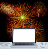 White screen laptop computer on office table. With fireworks background Royalty Free Stock Photo