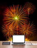 White screen laptop computer on office table. With fireworks background Stock Photography
