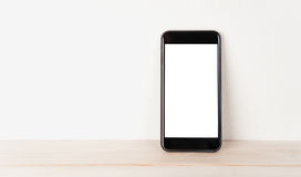 White screen phone rests against the wall. White screen phone rests against the wall Stock Photo