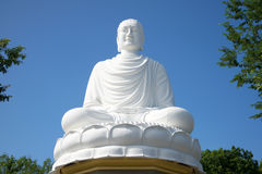White sculpture of a seated Buddha in Long Son pagoda on a sunny day. Vietnam, Nha Trang. White sculpture of a seated Buddha in Long Son pagoda on a sunny day royalty free stock image