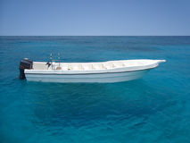 White sea boat. White sea speed boat on silent bright blue sea Royalty Free Stock Image