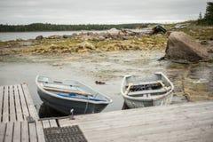 White sea boats. White sea. Russian nord. Polar circle. Boats in Nilmo Guba Stock Photography