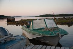 White sea boats. White sea. Russian nord. Polar circle. Old boats in Nilmo Guba Royalty Free Stock Photos