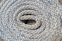 White sea cord on wooden surface, round bulk Stock Photos