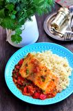 White sea fish cooked in a spicy tomato sauce with sweet pepper, cumin, garlic and coriander. Stock Photo