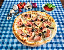 White seafood pizza with olives stock images