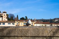 White seagull sitting on the stone bannister with a city background - Image stock images