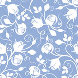 White seamless floral pattern with rose buds on blue. Vector illustration. Royalty Free Stock Images