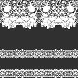 White seamless lace on black Royalty Free Stock Image