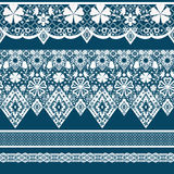 White seamless lace pattern on blue Royalty Free Stock Photo