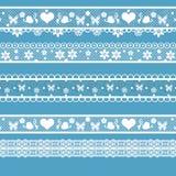 White seamless lace pattern on blue Royalty Free Stock Photo