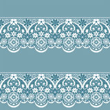 White seamless lace pattern on blue background Royalty Free Stock Photography