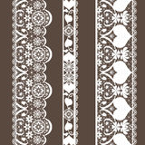 White seamless lace pattern texture on brown Stock Image