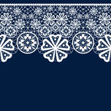 White seamless lacy lace pattern on blue Royalty Free Stock Images
