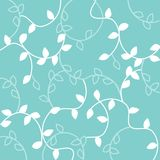 White seamless leaves pattern isolated on green background. Elegant seamless leaves pattern: green leaf over white background, ideal for wallpaper Royalty Free Stock Photos