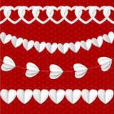 White seamless paper garlands from hearts Stock Image