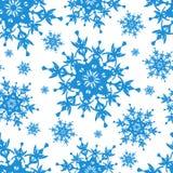 White seamless pattern with blue snowflakes. Beautiful white background seamless pattern with blue ornate stylized snowflakes. Seasonal winter festive seamless Stock Image