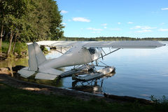 White seaplane on the lake shore Royalty Free Stock Photography