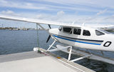 White seaplane in water Stock Photography