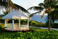 White seaside pavilion in the park. A white wooden pavilion in the park located on the Caribbean shore Stock Photography