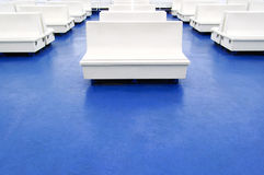 White seat or bench on a ferry boat as background Stock Images