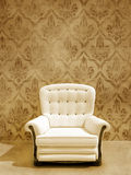White seat on damasque wall. Classic white seat on vintage damask wall Royalty Free Stock Photography