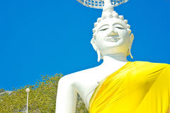 White Seated Buddha image and blue sky in the  Thai temple Royalty Free Stock Photo