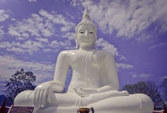 White Seated Buddha Image with Cloudy Blue Sky Background Royalty Free Stock Photos