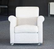 White second-hand chair in furniture warehouse. White second-hand chair in a furniture warehouse Royalty Free Stock Photos