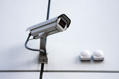 White security cam. Era on modern facade Stock Image