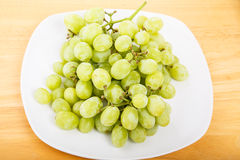 White Seedless Grapes on White Plate Royalty Free Stock Photos