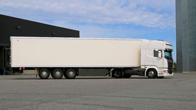 White Semi Trailer Truck on a Warehouse Yard stock images