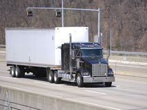 White Semi Truck. On the Highway Stock Photography