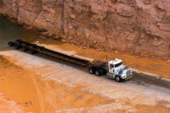 White semi truck and long oversized trailer Royalty Free Stock Photo