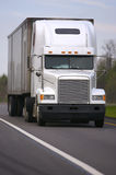 White Semi Truck on Road. Close Up Front View of White Semi Truck on Road Stock Image