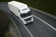 White semi truck on road Royalty Free Stock Photo