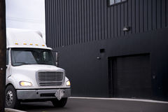 White semi truck Standing near the warehouse facilities Royalty Free Stock Photo