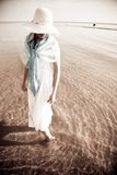 White sense. Young woman in the white wear walking on the beach Stock Photo