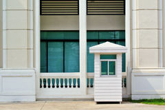 White sentry box and building Royalty Free Stock Photography