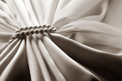 White sepia background with silk and pearl Stock Photography