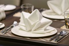 White serviette decorated on dinner set table Stock Photography