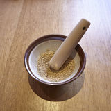 White sesame with grinder on wooden table. Lifestyle gourmet Royalty Free Stock Image