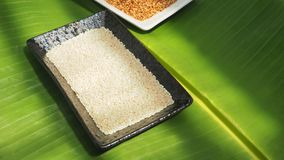 Background white sesame seed and roasted on banana leaf green co Royalty Free Stock Photos